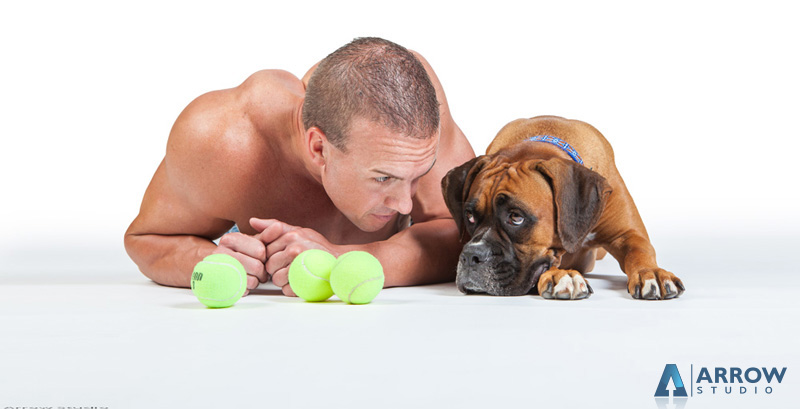 Man, dog and tennis balls