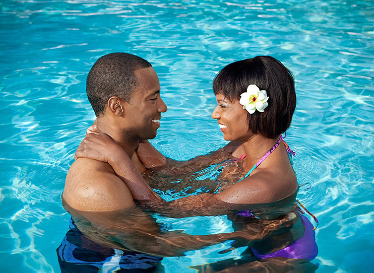 Couple in a pool in a lifestyle photo in Florida
